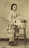 Louvenia Bell Cooper, 8 years old. (around 1871, tintype). The china head doll is now a family heirloom.
